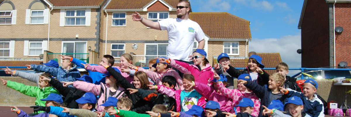 teacher pointing with school children to the left