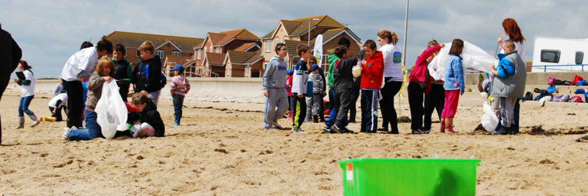 children at the beach handling equipment