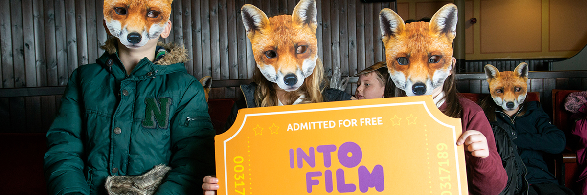 children with fox masks over their faces holding a giant into film golden ticket