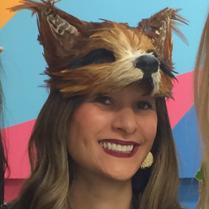 Belinda Surjadi smiling with fox mask on