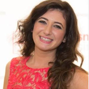 Pamela Uddin smiling in red dress