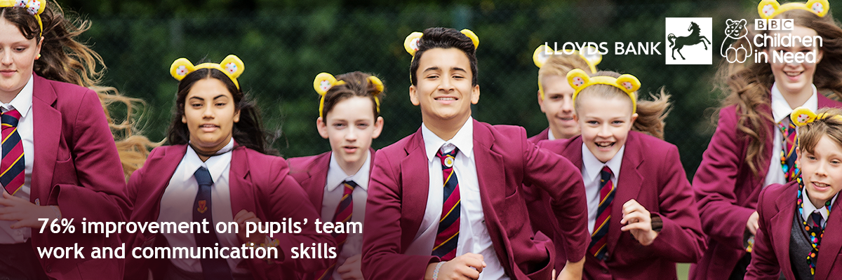 School children in uniform wearing Pudsey ears running outside and '76% improvement on pupils' team work and communication skills' stat