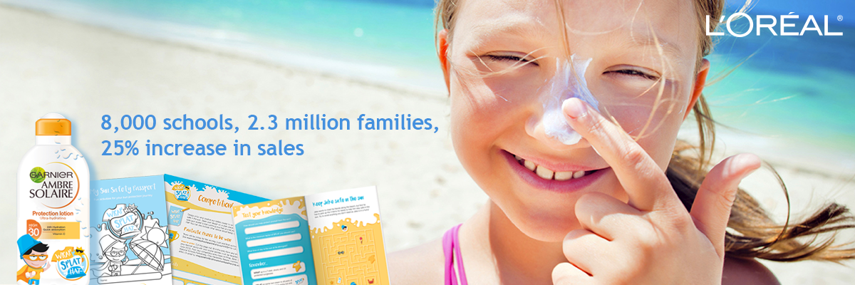 young girl on the beach in the sun putting suncream on her nose and smiling with 8,000 schools, 2.3 million families, 25% increase in sales stat