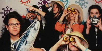 We are Futures team in a photo booth with explorer gear at the superbugs exhibition at the science museum