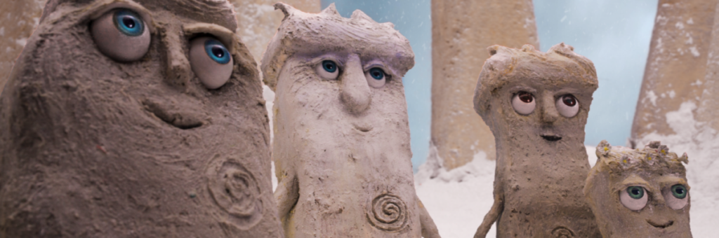 Hengeling puppets looking at the sky with a snowy Stonehenge behind